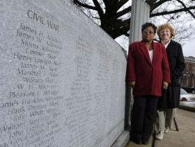 Jo Ann McClellan and Elizabeth Queener helped add names to the Maury County War Memorial. George Walker IV / The Tennessean