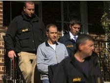 Ryan Loskarn is escorted from his Washington DC home by US Postal Inspectors following his arrest on child pornography charges.