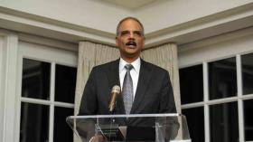 US Attorney General Eric Holder / February 7, 2014 / Reception for baseball Hall of Famer Hank Aaron in Washington, DC / Photo by Nick Wass/AP