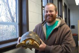 "Michael Ogle, Assistant Curator of Herpetology at the Knoxville Zoo, with Radiated Tortoise, ""O.G."""