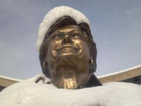 Pat Summitt's statue on the University of Tennessee campus beams with pride, despite a new hat and coat made of snow, courtesy of an overnight winter storm.