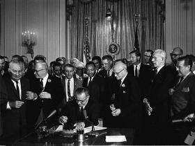 President Lyndon B. Johnson signs the Civil Rights Act, July 2, 1964.