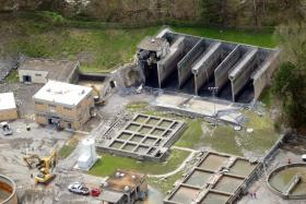 Damage from the rupture of a sewage containment tank is seen Tuesday, April 5, 2011 at the Gatlinburg Water Treatment Plant. (photo: Adam Brimer/Knoxville News Sentinel)