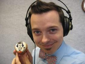 WUOT's Brandon Hollingsworth poses with a delicious cupcake from Magpies.