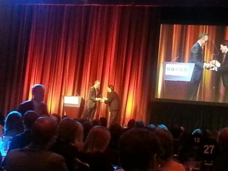 WUOT's Matt Shafer Powell receives the National Edward R. Murrow Award from NBC's Lester Holt