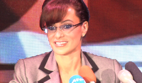 A Sarah Palin-lookalike stripper expounds on politics at a press conference.