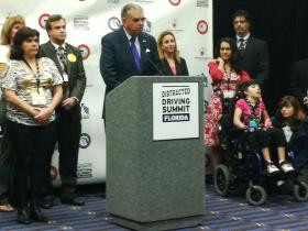 Transportation Secretary Ray LaHood next to a victim of a driving accident