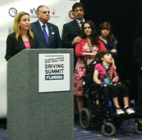 Jennifer Smith with U.S. Transportation Secretary Ray LaHood and a victim of distracted driving
