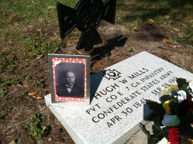 A photograph of Hugh Washington Mills and fresh flowers adorn the Confederate Veteran's new headstone, dedicated 10 February 2013 at Woodlawn Cemetery, Tampa, Florida.