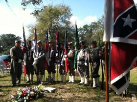The Color Guard from Tampa's Sons of Confederate Veterans organization participated in the headstone dedication ceremony for Confederate Pvt. Hugh Washington Mills.
