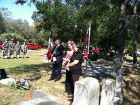Master of ceremony Bob Hatfield, great, great granddaughter Sandy Benitez, and Tammy Inman, genealogy hobbyist during the headstone dedication ceremony for Confederate Veteran Pvt. Hugh W. Mills at Woodlawn Cemetery, Tampa, Florida.