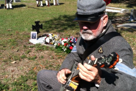 Wayne Sweat, a member of Tampa's Sons of Confederate Veterans camp, plays the banjo for the dedication ceremony of Confederate veteran, Pvt. Hugh W. Mills, on 10 February 2013.