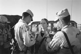 Kayla Williams, an Arabic linguist with the 101st Airborne Division, being promoted to SGT/E5 in Tall 'Afar.