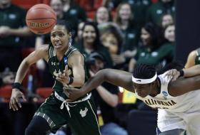 USF's Andrea Smith makes a first-half steal as California's Talia Caldwell gives chase during Monday night's second-round NCAA tournament game.