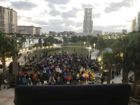 Several hundred people watch the documentary premiere on a big screen set up outside the Tampa Bay History Center