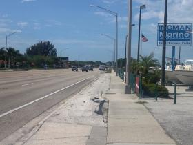 Northbound bus stop on U.S. Highway 41 across the street from USF Sarasota-Manatee. To reach campus, bus riders have to cross all seven lanes of traffic with no crosswalks or signals to slow drivers down.