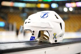 "A example of the Tampa Bay Lightning's ""Boston Strong"" helmet up for auction to benefit victims of the Boston Marathon bombing."