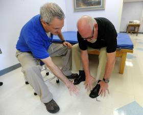 Occupational Therapist Erik Spahn works with Bruce Wright, a patient living with Parkinson's disease, as they demonstrate flicking his fingers as he gets his mind ready to tie his shoes. These and other physical therapy techniques are used to retrain the mind to do everyday things. Wright undergoes physical therapy at Florida Hospital Tampa's physical therapy facility.