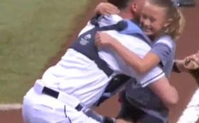 Alayna Adams leaps into the arms of her father, Lt. Col. Will Adams, after he surprised her at Thursday night's Rays game.