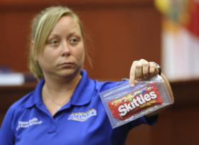 Diana Smith, crime scene technician for the Sanford Police Department, shows the jury a bag of Skittles, which was collected as evidence at the crime scene, during Zimmerman's trial Tuesday