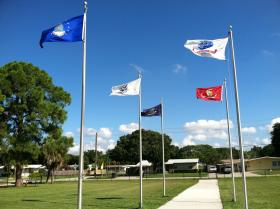 The flags for each of the five military services fly outside the entrance to Monroe Middle School, the public school for children living on MacDill Air Force Base.