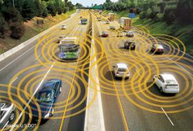 An artist's concept of a highway where vehicles talk to each other and can automatically react if another vehicle comes too close.