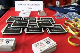 Kitchen magnets and rests for motorcycle kick-stands are among the handouts that promote the Veterans Crisis Line.