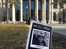 This Feb. 4, 2014 file photo shows a small memorial to Jordan Davis planted outside the courthouse in Jacksonville