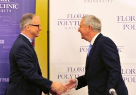 Randy Avent, left, shakes hands with Florida Polytechnic Board of Trustees Chair Rob Gidel.