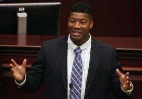 "Florida State Univ. quarterback & 2013 Heisman Trophy winner Jameis Winston speaks at the State Capitol as part of ""FSU Day"" Tuesday."
