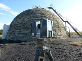 "A 3D laser scanner in front of one of the ""beehive"" bunkers where launches at Cape Canaveral could be observed from."