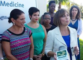 U.S. Rep. Kathy Castor (right) talks about a community initiative to increase the number of children receiving vaccinations against HPV at a Tampa news conference June 30th that also featured Moffitt researcher Anna Giuliano (left), USF Public Health students and other Bay area medical professionals.