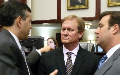 Senator JD Alexander, center, talks with his colleagues