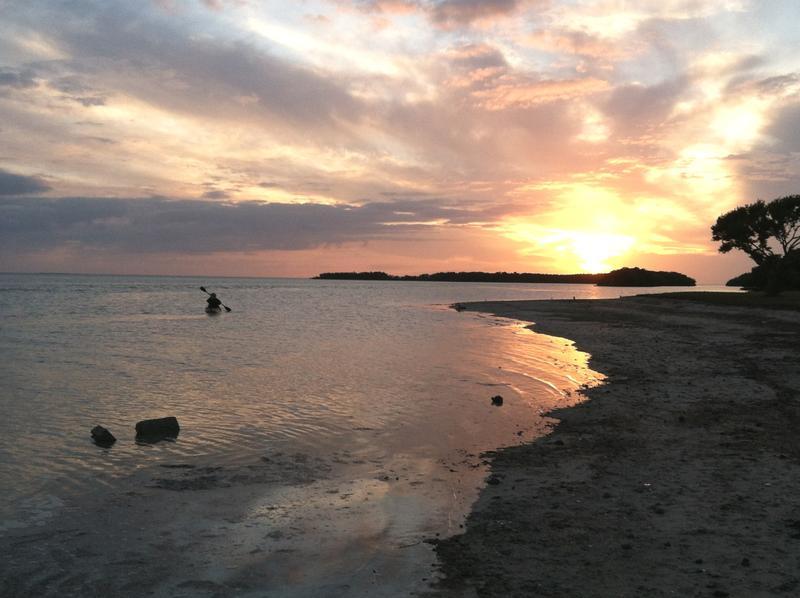 Sunset frames kayaker at Everglades National Park