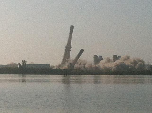 The three smokestacks tumble down one by one.