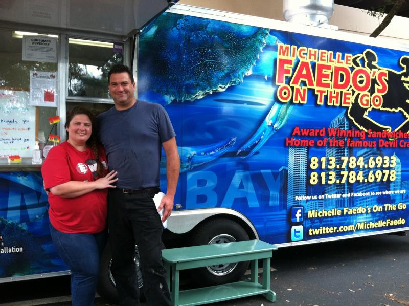 Michelle and Robert Faedo standing next to their food truck after serving the lunchtime crowd in Brandon last month.