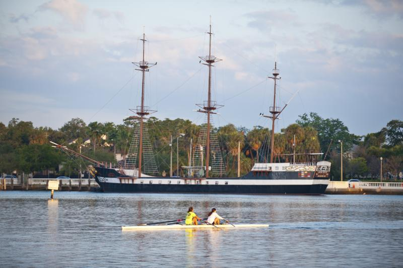 Scullers in front of the Jose Gasparilla