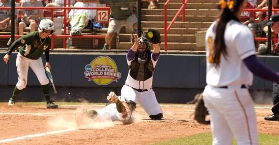 LSU catcher Morgan Russell prepares to tag USF's Ashli Goff out as she tries to score in the third inning of Saturday's game.