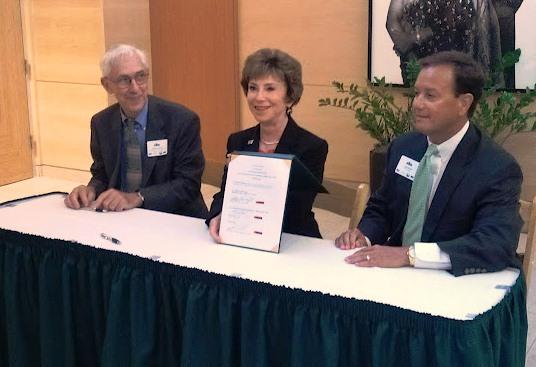Hillsborough EPC Executive Director Richard Garrity, USF President Judy Genshaft & TECO Energy President/CEO John Ramil with the Clean Cities agreement