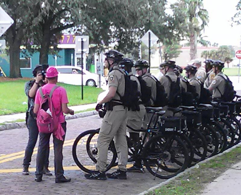 A photographer captures a Code Pink demonstrator talking to officers