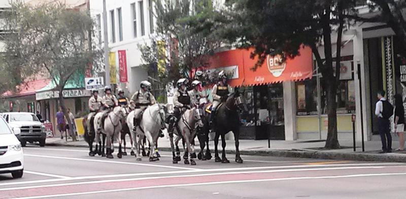 Law enforcement on horseback patrol downtown Sunday.