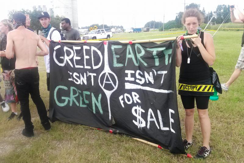 Protesters & banner at TECO's Big Bend Power Plant