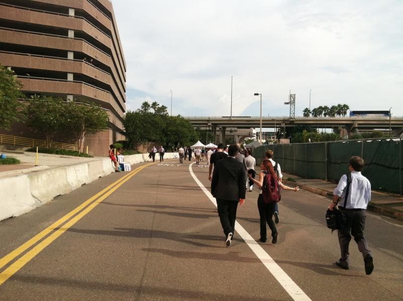 Meanwhile, on the other side of downtown, delegates walk to the convention site.