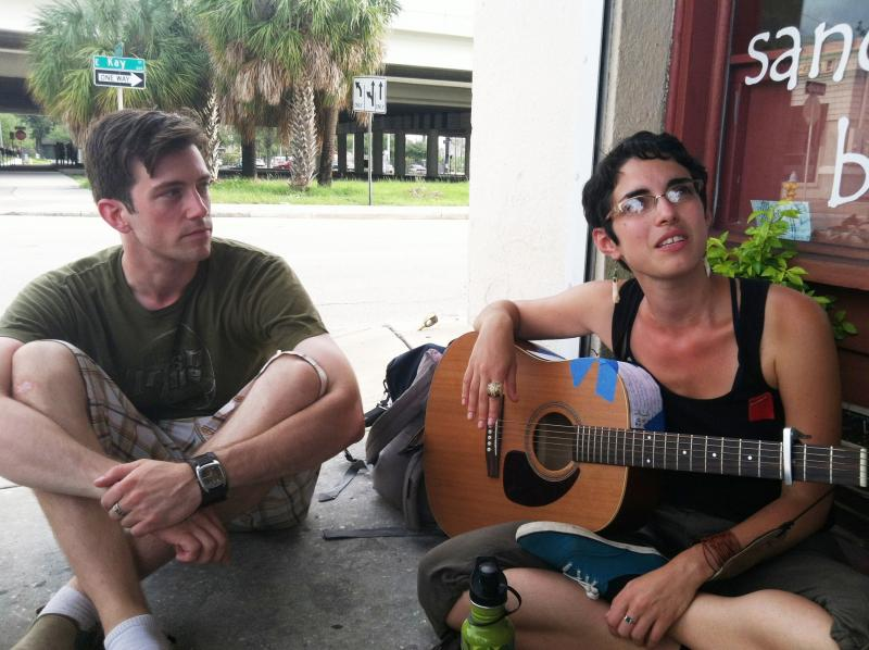 Justin West and Heather Merlis jam outside the Cafe Hey