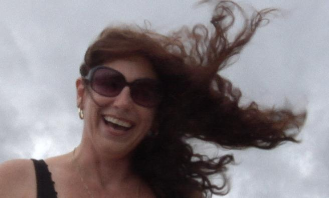 A Tampa Bay resident braves the wind on Bayshore Boulevard Monday as Tropical Storm Isaac moves closer.