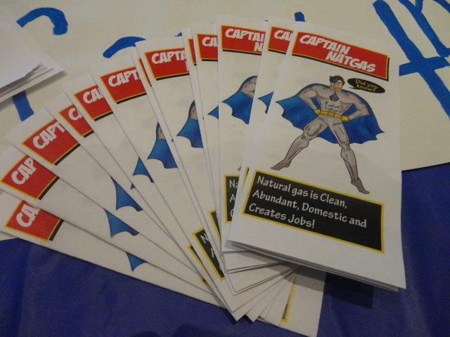 Brochures featuring Captain NatGas promote natural gas at a USF event