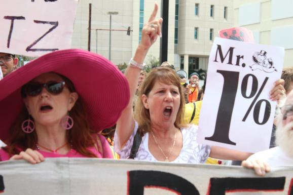 Code Pink protesters march for women's rights.