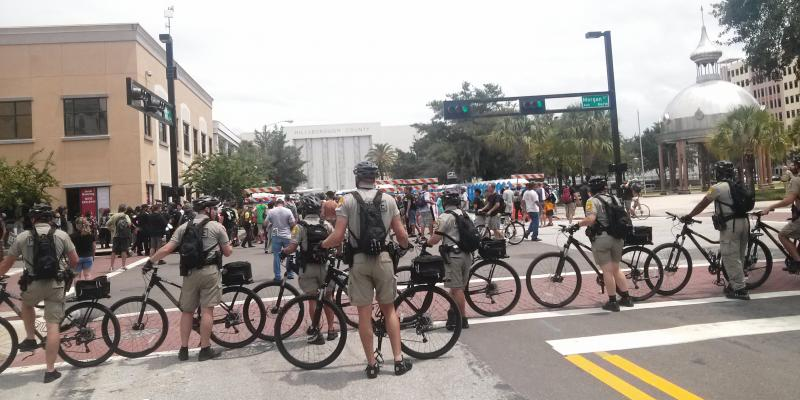 Law enforcement on bicycles surround a protest group near Tampa's old County Courthouse on Monday, August 27.