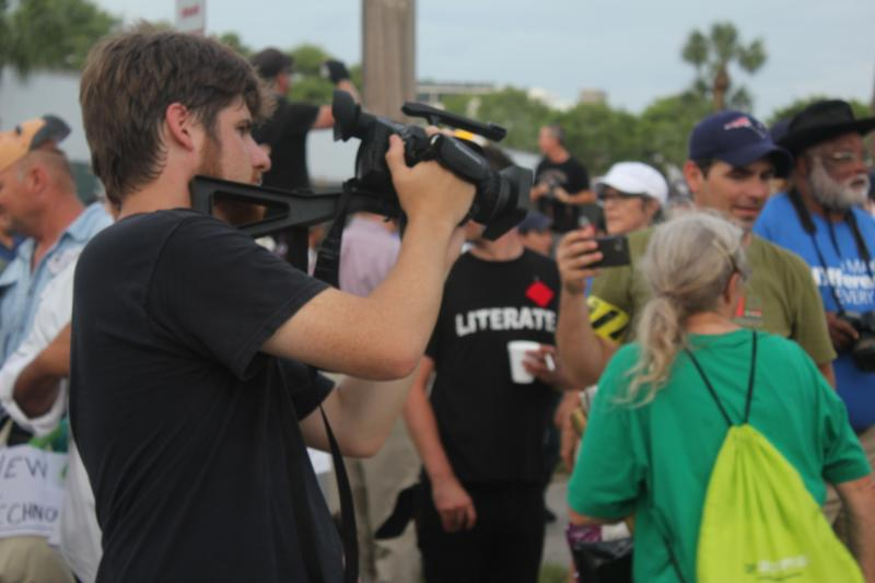 Videographer Alex Cook covers a protest