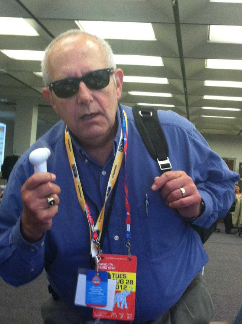 "The Convention Today host Craig Kopp with some of the complentary ""swag"" given to reporters"